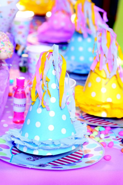 Carnival party: Glue a few colourful strands of streamers to the tops of your party hats for an extra pop of colour.