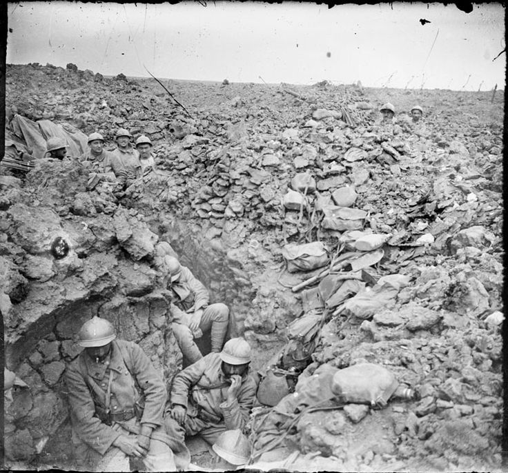 French soldiers manning badly damaged trenches near Hill 304 at Verdun, July 1917.