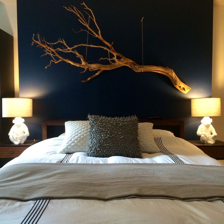 driftwood art over bed