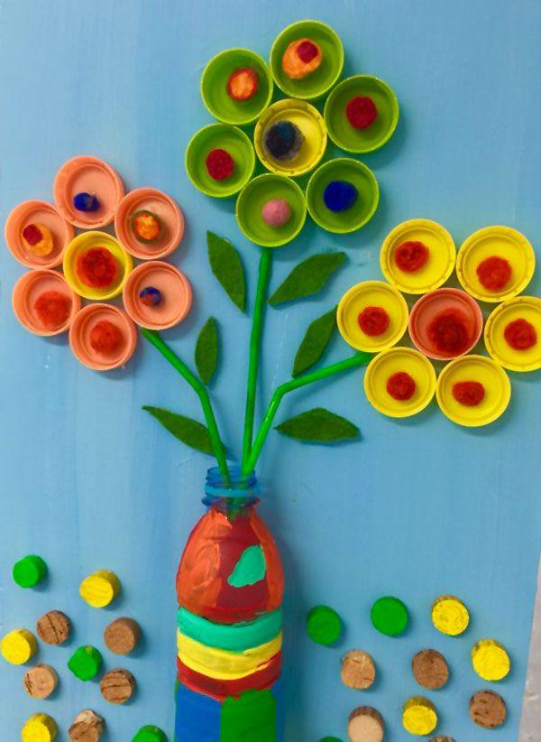 Lavoretto con tappi di plastica: i fiori