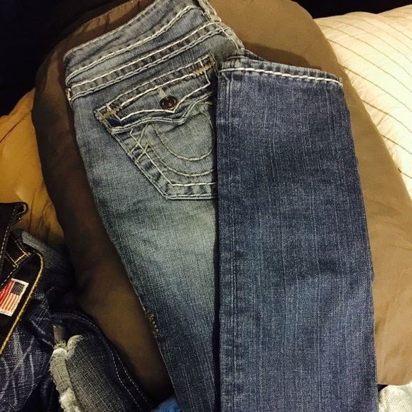 Jeans Light blue faded into a darker blue with grey stitching. True Religion Jeans