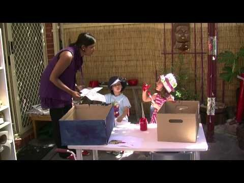 Vignette No. 26: 'Car Factory'... This vignette shows two children interacting with each other and with an educator to create a car from a cardboard box. It also features children's interactions and collaborations and educators' engagement and language.