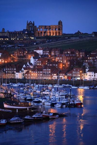 Whitby Harbour with the ruined Abbey beyond. North Yorkshire, England (by John Hill on Fivehundredpx)