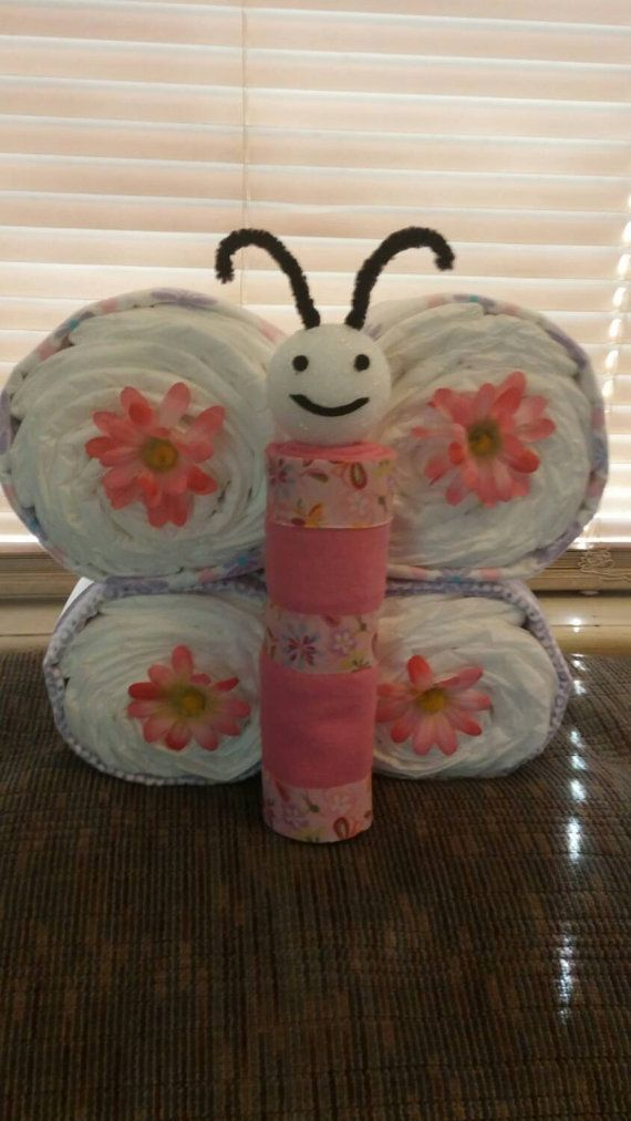 Check out this item in my Etsy shop https://www.etsy.com/listing/236948012/any-color-butterfly-diaper-cake