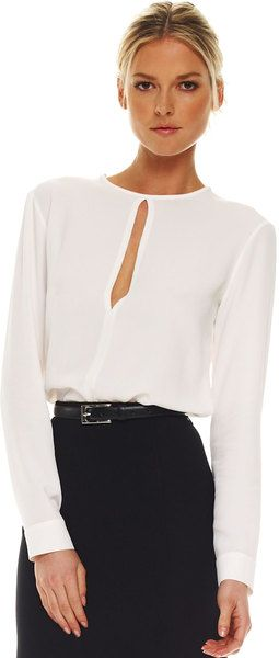 Nice twist on a classic look - A white blouse this simple and beautiful can't help but be elegant.