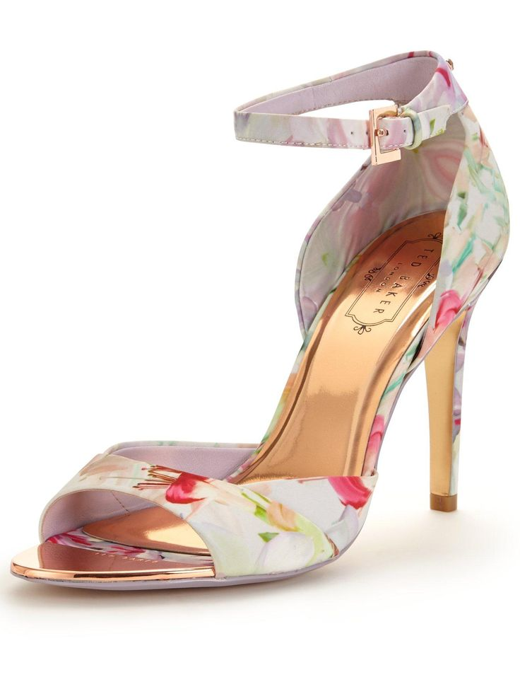 Ted Baker Caleno Floral Heeled Sandal - Pink Step up your footwear game just in time for spring, with Ted Baker's supremely pretty Caleno floral heeled sandal. A cut above the rest when it comes to new-season styling, the Caleno showcases SS16's barely-there shape, giving it a luxe twist with TB's signature shiny gold lining and inner heel. Adorned with a bloom of florals and gold-toned hardware, this pair is the definition of chic, feminine dressing. Summer soirées require little more than…