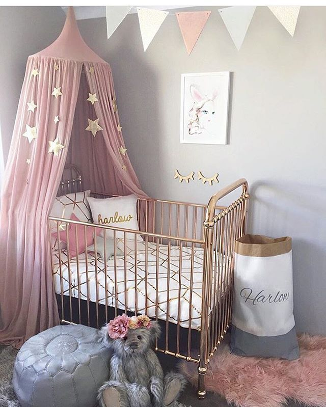 NURSERY / / Stunning gold cot by @incy_interiors is the star of this nursery, with a dusty pink canopy at one end and lovely grey and gold accessories like the bunting flags and star cushions. By stylish mama @hudson_and_harlow ✔️