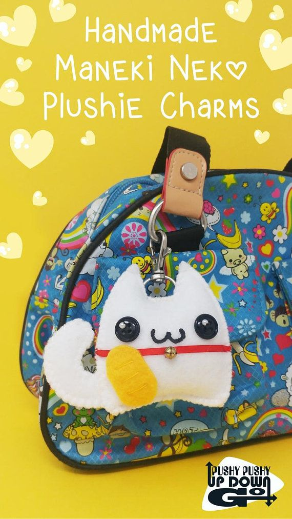 Clip some kawaii to your favorite bag with a cute handmade maneki neko cat plushie charm! Purr-fect for purses and backpacks, as a unique keychain, or a sweet good luck charm. #cats #handmade #charms #kawaii #cute #manekineko #otaku #goodluckcharm #neko #whitecat
