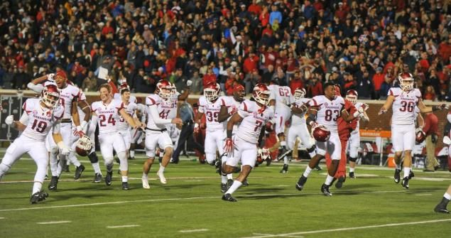 Arkansas celebrates an unlikely victory over Ole Miss.