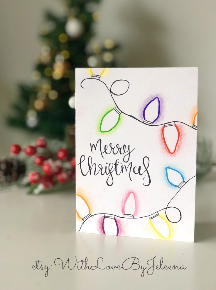 Handmade Christmas cards with Christmas lights and calligraphy. You can purchase…