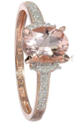 Morganite and Diamond Ring Morganite é uma variedade cor de pêssego de berilo.É muito apreciada em joalharia para fazer jóias.Esta pedra semi-preciosa partilha pedras tão famosas como a esmeralda e a agua-marinha.