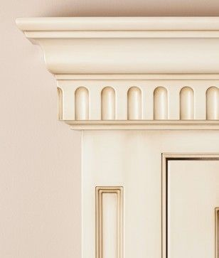 We are showing a Single Bead Inset frame cabinet with an integral Recessed Ashbury filler as the frame stile. Our EKFL2 Fluted sub moulding is used with our EKPC4 crown.