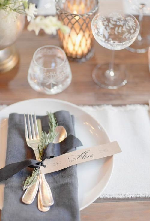 silverware tied with a ribbon and an herb sprig