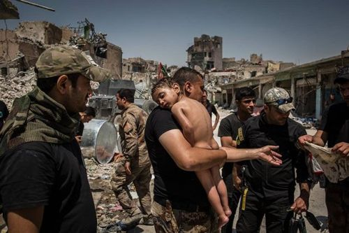 An unidentified young boy who was carried out of the last ISIS-controlled area in the Old City by a man suspected of being a militant is cared for by Iraqi Special Forces soldiers. In early July after months of fighting the Iraqi government declared the city of Mosul fully liberated from ISIS although conflict continued in pockets of the city. Thousands of civilians were killed during the battle for Mosul while large areas of the city were left in ruins. The Battle for Mosul  Young Boy Is…
