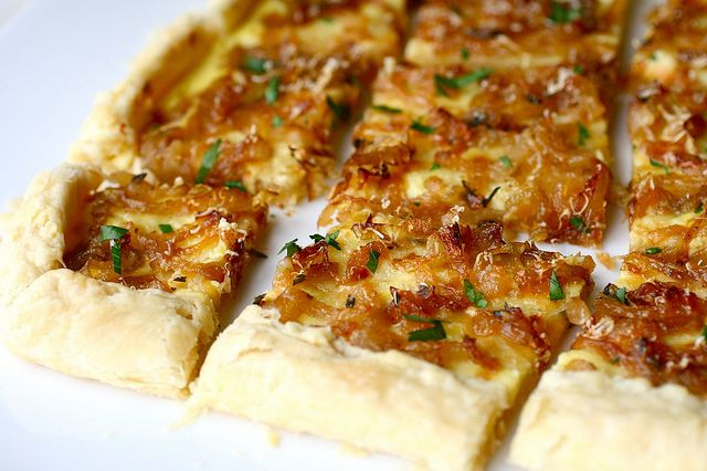 Caramelized Onion Tart - I have been wanting to make one of these for a long time now. Love the way caramelized onions taste - I agree with Annie, they are magical! I think this could stand alone as a meal!