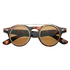 I've got these and I want them in every colour. The steam-punk look is a risky one, but people seem to be jumping on the John Lennon frames these days.