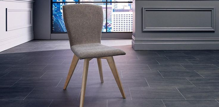 A contemporary dining chair, upholstered in our exclusive Ellen fabric with solid timber legs for support