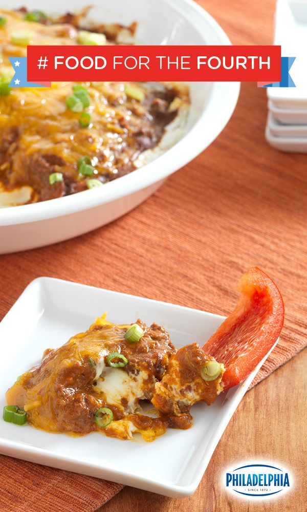 There will be fireworks when this Cheesy Chili Dip meets your mouth this 4th of July, featuring PHILADELPHIA Cream Cheese, KRAFT Shredded Sharp Cheddar Cheese, chili, and chopped green onion!
