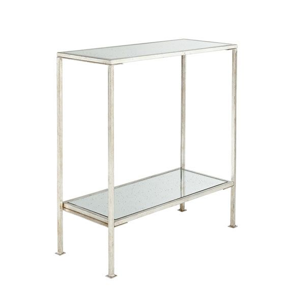 Sophisticated simplicity defines our Rivulet Side Table. It features an Antique Silver metal frame with a mirrored top and bottom shelf. This narrow side table would also work beautifully as a bar. Matching consoles are also available in large and small sizes.