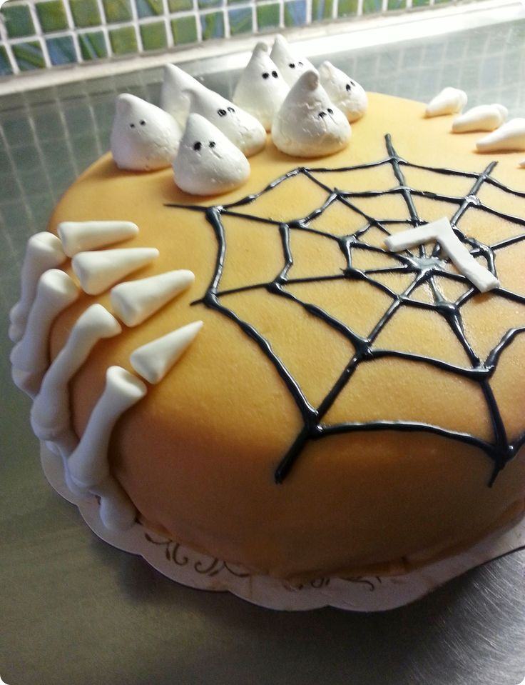 Halloween cake. Fingers are made in sugarpaste, merengue ghost's