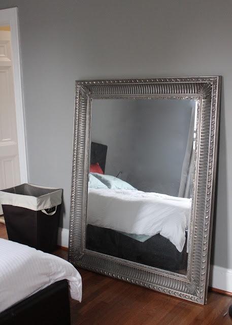 Gray bedroom, large mirror