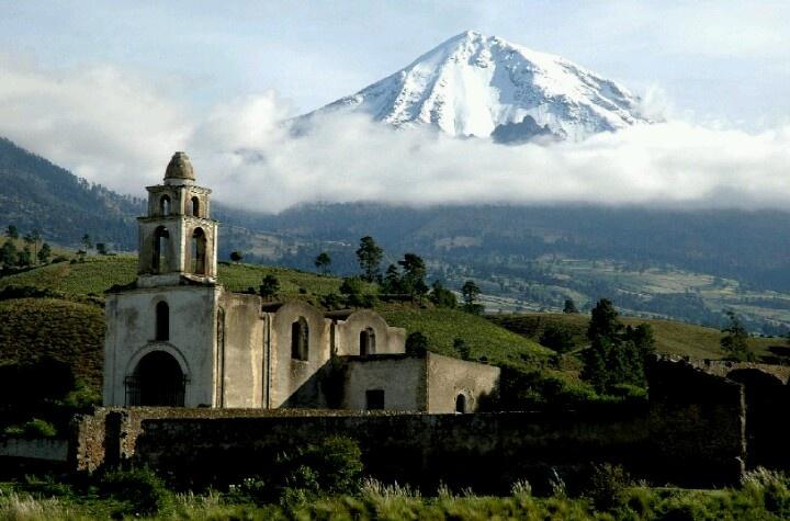 Church near Puebla, Mexico with Pico de Orizaba (a semi-active volcano) in the background.