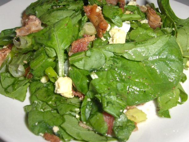 I served this terrific salad to guests and it was a hit! Pour the hot dressing over the salad right before serving time. I found this recipe in an old Farm Journal cookbook. Cook time is for the time it takes to boil the eggs and fry the bacon.