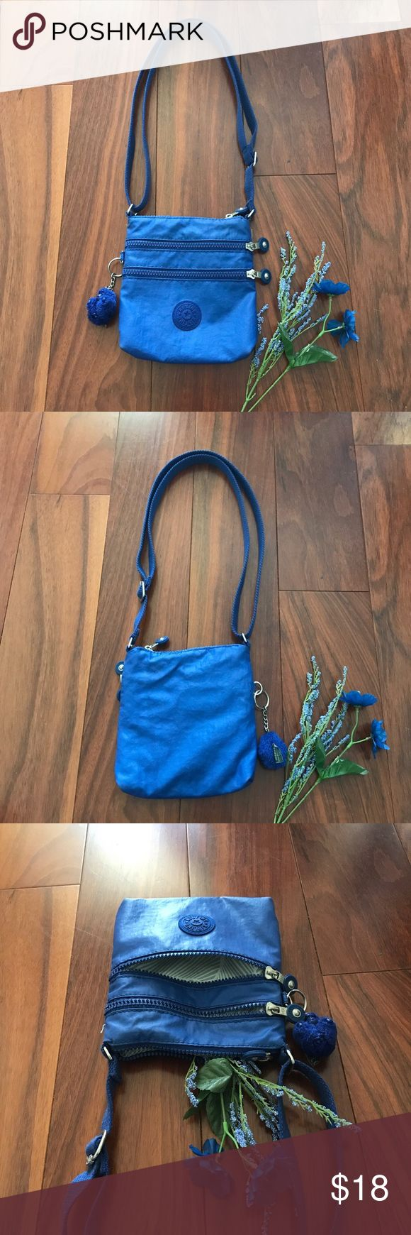 Blue Kipling Petite Bag Super cute and trendy Kipling bag! The perfect summer color, goes with anything and just adds a beautiful accessory to whatever you're wearing! In perfect condition!! On sale!! 🦋🦋 Kipling Bags Shoulder Bags
