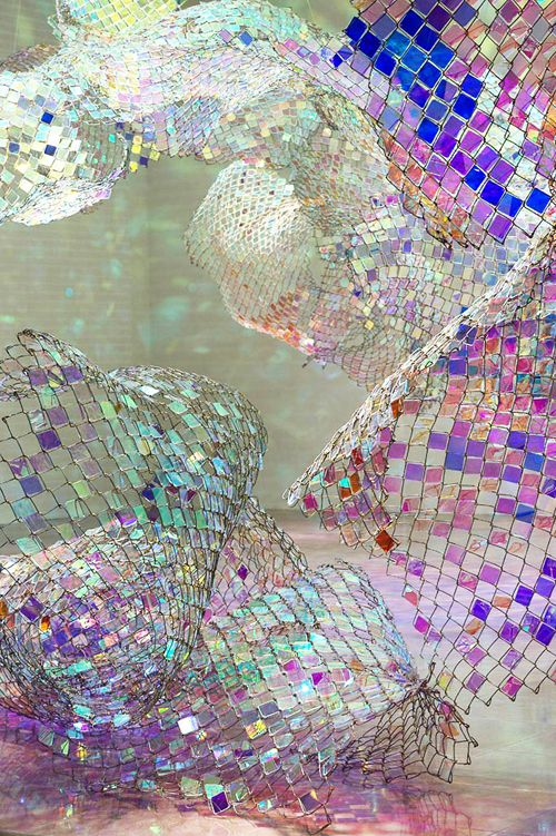 Sculptures created from rainbow iridescent Perspex and light-reflecting tiles