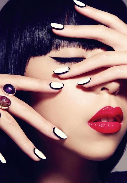 Black edged white nail polish.