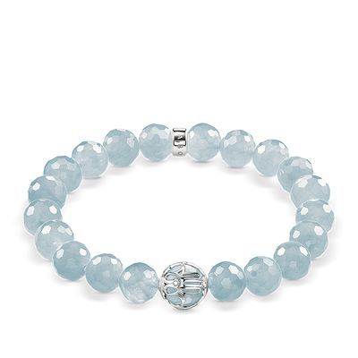 This stretch #THOMASSABO bracelet comprises faceted milky aquamarine beads, protectively enveloped by the Hand of Fatima in Sterling silver, embellished with white #diamonds.