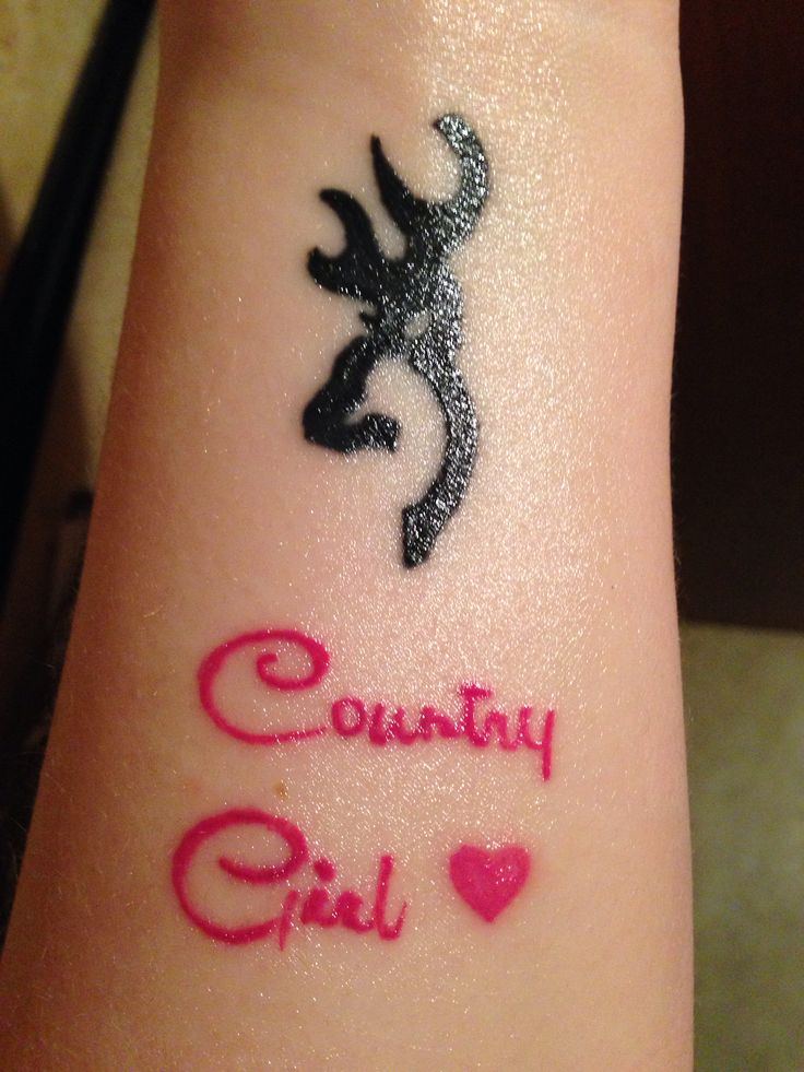 My wrist tattoo browning symbol with country girl underneath it .