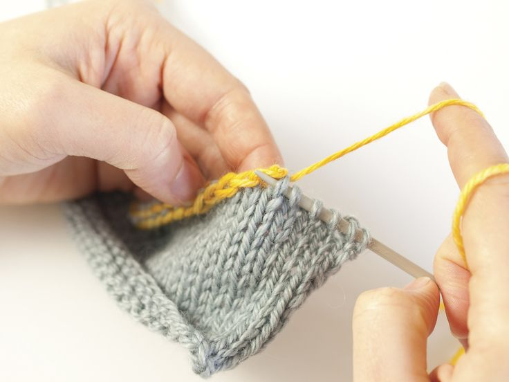 4. Continue to pick up stitches with the working needle