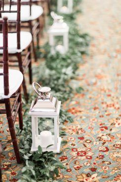 Greenery wedding ceremony decor with lanterns