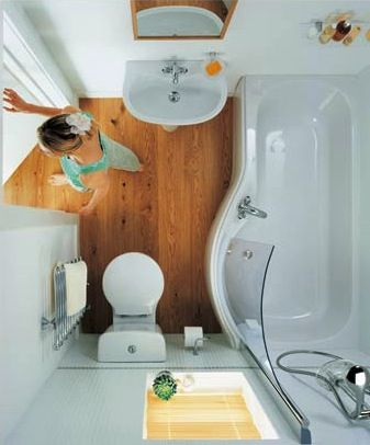5 Tips for Space Saving & Spacious Feeling Tiny Bathrooms ------------------------------- Love this bathtub/shower with the half-glass shower guard and the faucet for baths on the side of the tub.