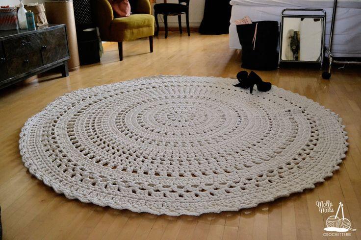 Huge crocheted doily carpet on the bedroom floor, diameter 2m.