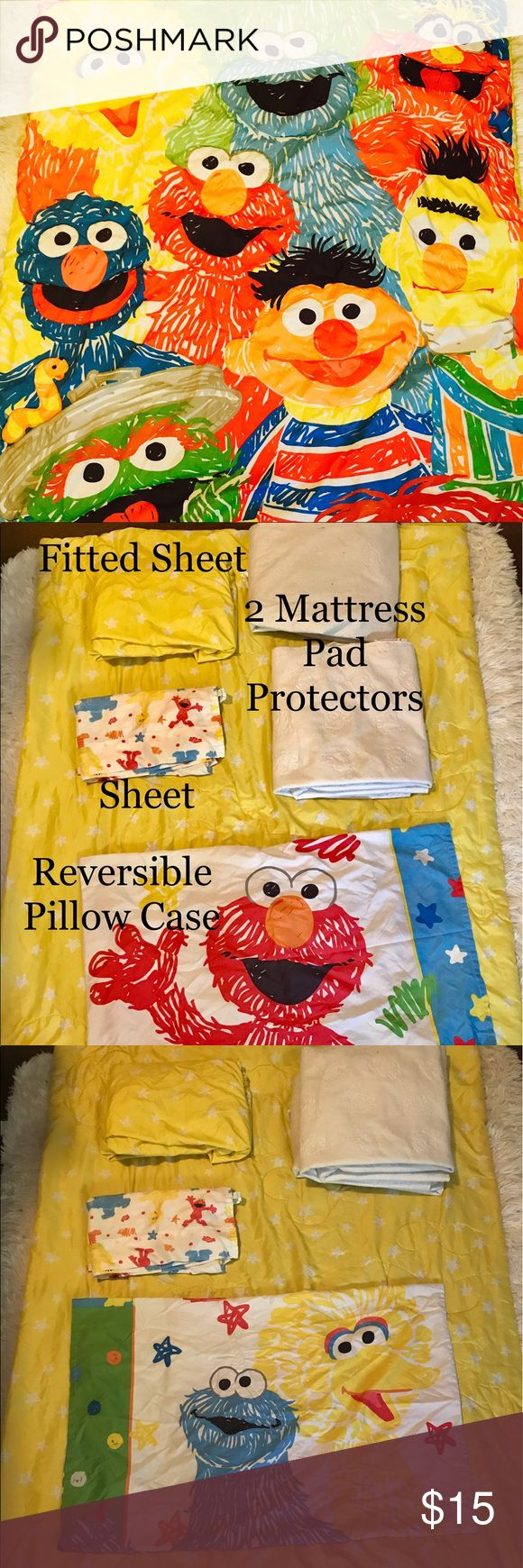 """Elmo Toddler Bed Comforter/Mattress Pad/and Sheets Reversible toddler bed """"Sesame Street Friends"""" reversible comforter, reversible pillowcase, fitted Sheet, flat sheet and 2 mattress pad protectors. All have been thoroughly cleaned, and ready for happy nights in your home! Other"""