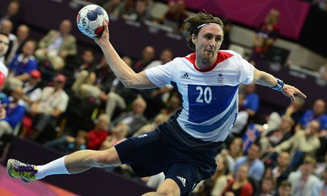 Britain's Mark Hawkins in action during a handball match in the Copper Box at the London Olympics