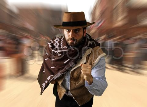 Stock photo of gunman runs in the far west