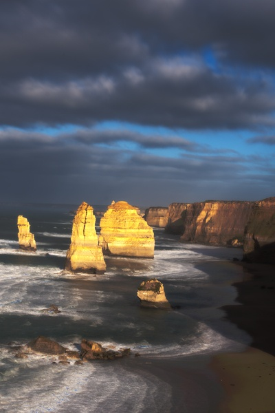 The Twelve Apostles rock formation, (photographed by Dr. Joseph McGinn) is only one of many unforgettable sights on Australia's Great Ocean Road.  Natural sights combine with intriguing opportunities, such as a visit to Torquay, Australia's iconic surfing city.  Learn more about Torquay and the Great Ocean Road at http://www.examiner.com/article/torquay-australia-is-the-perfect-winter-escape-to-sun-and-surf