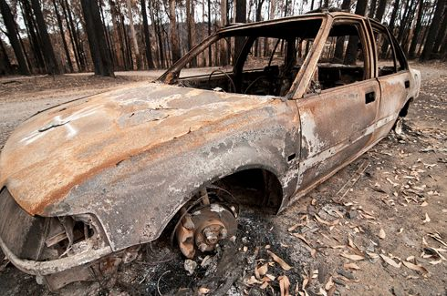 A burnt-out car at Kinglake after 2009's Black Saturday fires in Victoria: whether residents in fire-prone areas plan to leave early or stay and defend, a reliable and adaptable bushfire survival plan is a must.