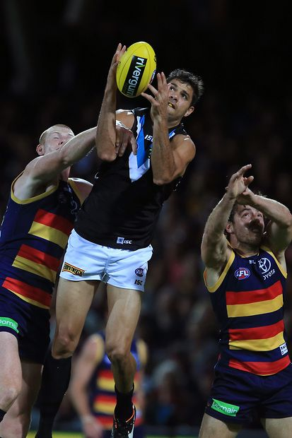 Patrick Ryder of the Power marks over Sam Jacobs of the Crows during the 2015 AFL Round 05 match between the Adelaide Crows and Port Adelaide Power at Adelaide Oval, Adelaide on May 03, 2015. (Photo: James Elsby/AFL Media)