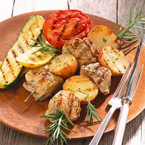 The fresh rosemary and mustard vinaigrette imparts a subtle but distinctive flavor to these grilled potato and pork kabobs. Lean pork tenderloin makes great kabobs and is easy to cut into cubes.