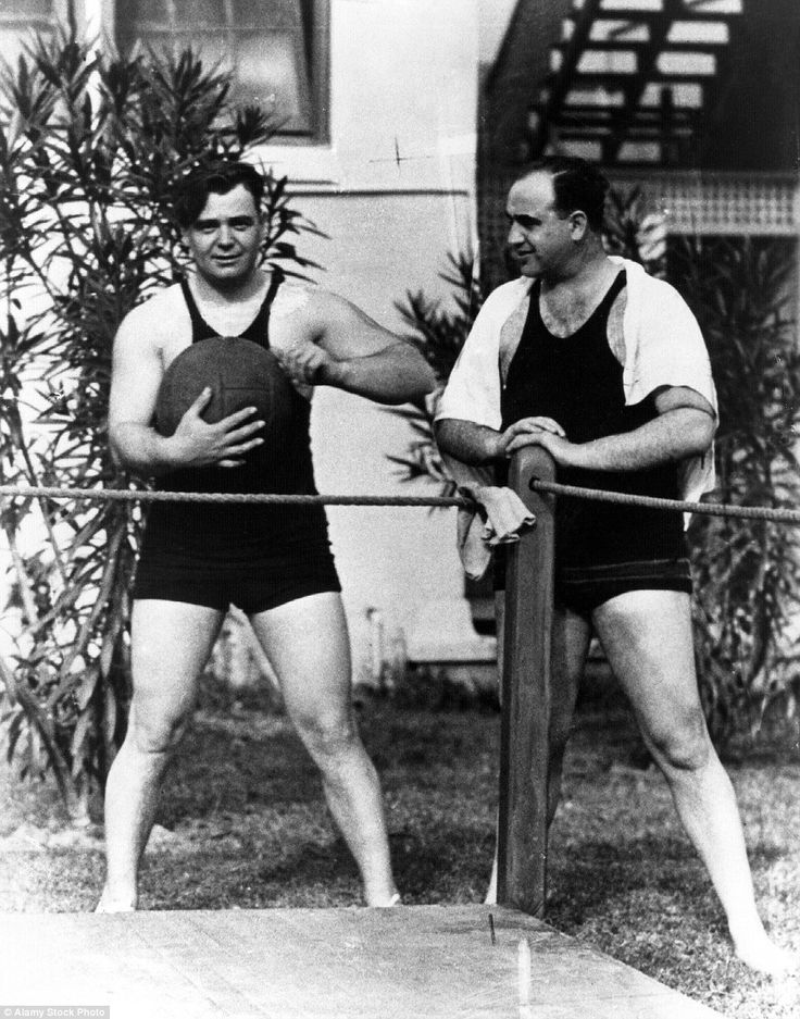 Capone and boxer Jim Braddock are seen at the Palm Island estate in the late 1920s