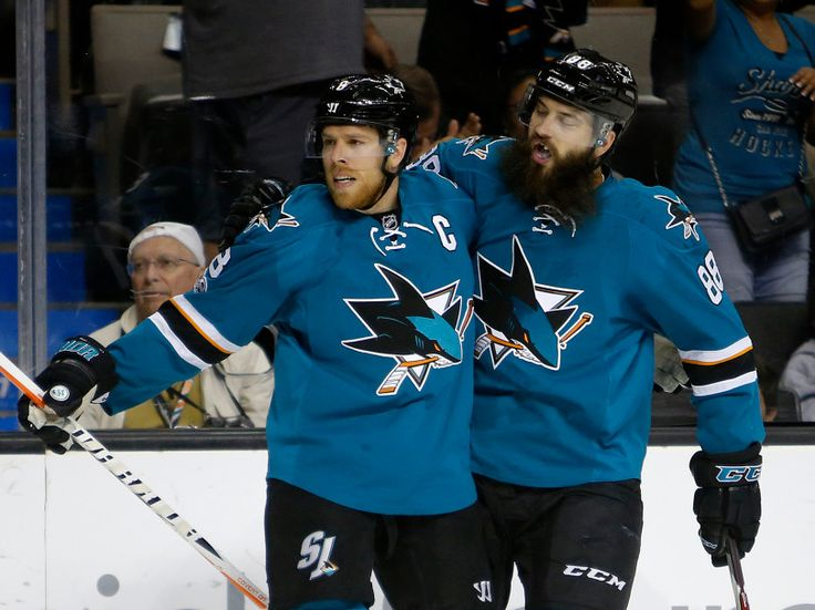San Jose Sharks' Joe Pavelski (8) celebrates with San Jose Sharks' Brent Burns (88) after scoring 2-1 goal against the Dallas Stars in the first period of their NHL game at SAP Center in San Jose, Calif., on Sunday, March 12, 2017. (Josie Lepe/Bay Area News Group)