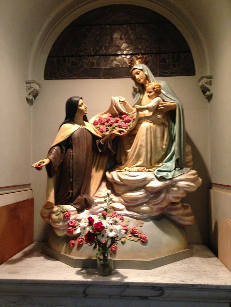 Our blessed Mother, Child Jesus, & St Therese. I took this photo at St Cecilia Catholic Church in St Louis, MO.