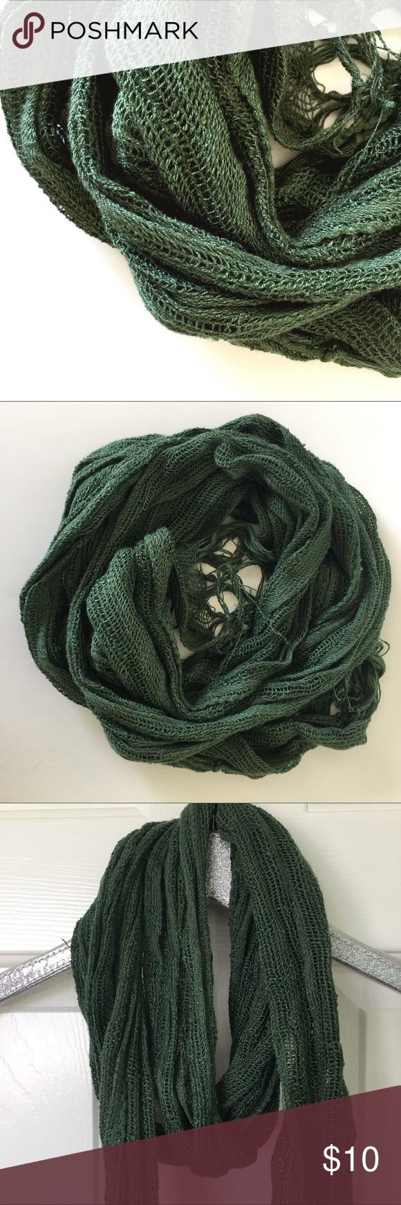 Green knitted long scarf This scarf is knitted and has an open weave. It is from world cost plus market.  A great layering scarf! World Cost Plus Market Accessories Scarves & Wraps