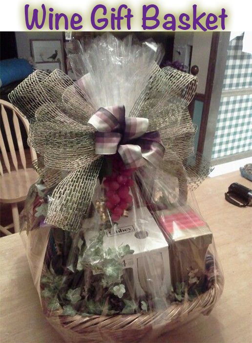 Wine Gift Baskets are unique and fun to make. Notice the artificial grapes dangling from the bow. This was created by Tracey (GiftBasketAppeal).