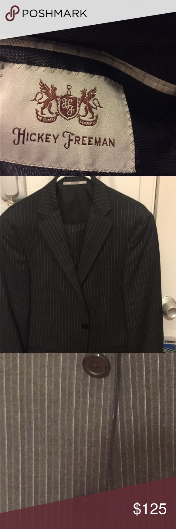 Men' Grey Pinstripe Suit Dark grey suit with white pinstripes! Nice soft fabric practically new. Pants are 31 waist and jacket is a 38. Hickey Freeman Suits & Blazers Suits