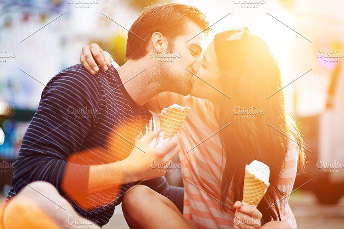 romantic couple kissing by rezart on @creativemarket
